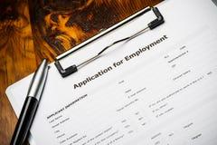 Job application. A job application on a clipboard with a pen Stock Photos