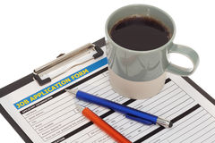 Job application form with coffee cup Stock Images