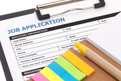 Job application form. With notepad Stock Photo