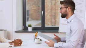 Employer having interview with employee at office. Job, business and employment concept - employer or hr manager having interview with indian male employee at stock video
