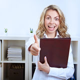 Job candidate holding thumbs up. Female happy job candidate with CV holding her thumbs up Royalty Free Stock Photography