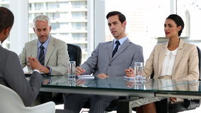Job candidate talking to business people stock footage