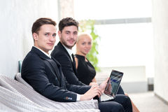 Job candidates. Three people in formalwear waiting in line while Royalty Free Stock Photography