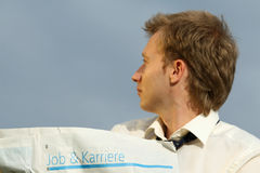 Job and career. Man reading a newspaper with jobs and career Stock Images