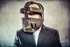 Job, dangerous business man with iron mask and expressions Royalty Free Stock Images