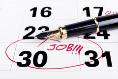 Job Deadline. Calendar with marked with red founain pen on the 30-th for job fining deadline Stock Photos