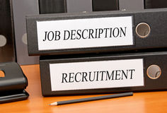 Job Description and Recruitment binders. On desk in the office Royalty Free Stock Image