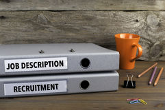 Job Description and Recruitment - two folders on wooden office d Royalty Free Stock Photo