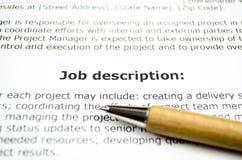 Job description with wooden pen royalty free stock photo