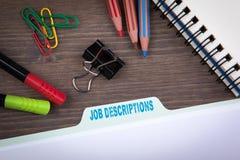 Job Descriptions. Folder Register on a dark wooden desk.  Stock Photo