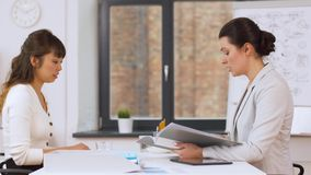 Employer having interview with employee at office. Job, fail and employment concept - employer or hr manager having interview with asian female employee at stock footage