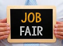 Job Fair - lavagna della tenuta del responsabile con testo Immagini Stock Libere da Diritti