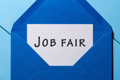Job Fair - mensagem de texto no envelope azul Fotografia de Stock Royalty Free