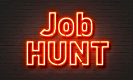 Job hunt neon sign on brick wall background. Stock Photo