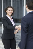 Job interview. Young woman coming to a job interview stock photo