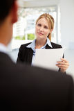 Job interview. Businesswomen holding papers interviewing male employee Royalty Free Stock Photo