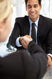 Job interview. Smiling and shaking hands royalty free stock photos