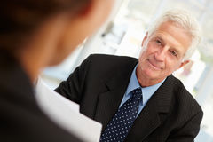 Job interview. Between a senior businessmen and women royalty free stock photo