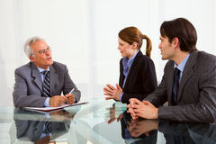 Job interview. Two men and one women during a job interview in office Royalty Free Stock Images