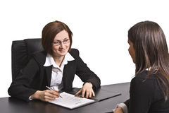 Job interview. Two businesswomen at an interview in an office.The documents on the desk are mine Stock Photos