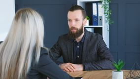 Job interview applicant company vacancy handshake. Job interview. Bearded hipster applicant. Blonde HR manager. Smiling candidate matching company vacancy stock video