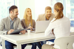 Job interview. Job applicant having an interview. Group of business people having job interview with young woman Stock Photos