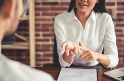 At the job interview. Beautiful female employer in suit is conducting a job interview while sitting in her office stock photography