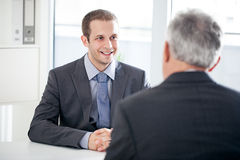 Job Interview. A candidate for a job talking to the interviewer royalty free stock photo