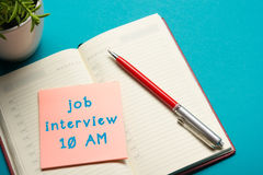 Job interview concept . Office table top view. Notepad, pen and reminder with word Royalty Free Stock Photos