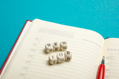 Job interview concept . Office table top view. Notepad, pen and reminder with word Stock Photos