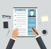 Job interview. Consideration by profiles of personnel concept Royalty Free Stock Photography