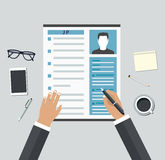 Job interview. Consideration by profiles of personnel concept Stock Image