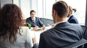 Job interview with the employer, businessman listen to candidate answers. Job interview with the employer, businessman listen to candidate answers royalty free stock photos