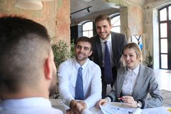 Job interview with the employer, businessman listen to candidate answers.  royalty free stock photos