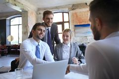 Job interview with the employer, businessman listen to candidate answers.  stock photo