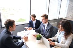 Job interview with the employer, businessman listen to candidate answers. Job interview with the employer, businessman listen to candidate answers stock photography