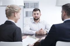 Job interview in international corporation. Nervous businessman during a job interview in an international corporation Stock Photography