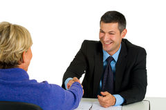 Job interview with man and woman. In white background Royalty Free Stock Photo
