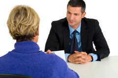 Job interview with man and woman. In white background Royalty Free Stock Photos
