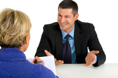 Job interview with man and woman. In white background Royalty Free Stock Photography