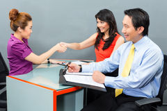 Job interview  for a new employment or hire in Asian office. Job interview with an Asian candidate for an new office employment or negotiation for hiring Royalty Free Stock Image