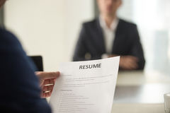 Job interview in office, focus on resume, close up view royalty free stock photo