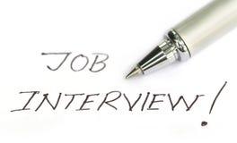 Job Interview op een Witboek wordt geschreven dat Stock Afbeeldingen