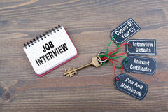 Job interview preparation concept. The key to success on a wooden office desk Stock Images