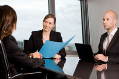 Job interview. Three persons human resources persons in a panorama office royalty free stock photography