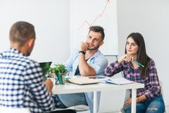 Job interview - two business partner listen to candidate stock image