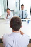 Job interview. Two business people having job interview with young man Royalty Free Stock Images