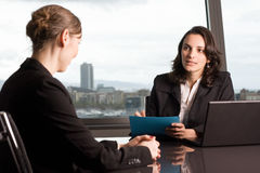Job interview. Two women job talk in a panorama office stock image