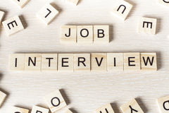 Job Interview-woord op houtsnede wordt geschreven die Houten ABC Royalty-vrije Stock Fotografie
