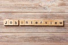 Job Interview-Wort geschrieben auf hölzernen Block Job Interview-Text auf Tabelle, Konzept Stockfotos